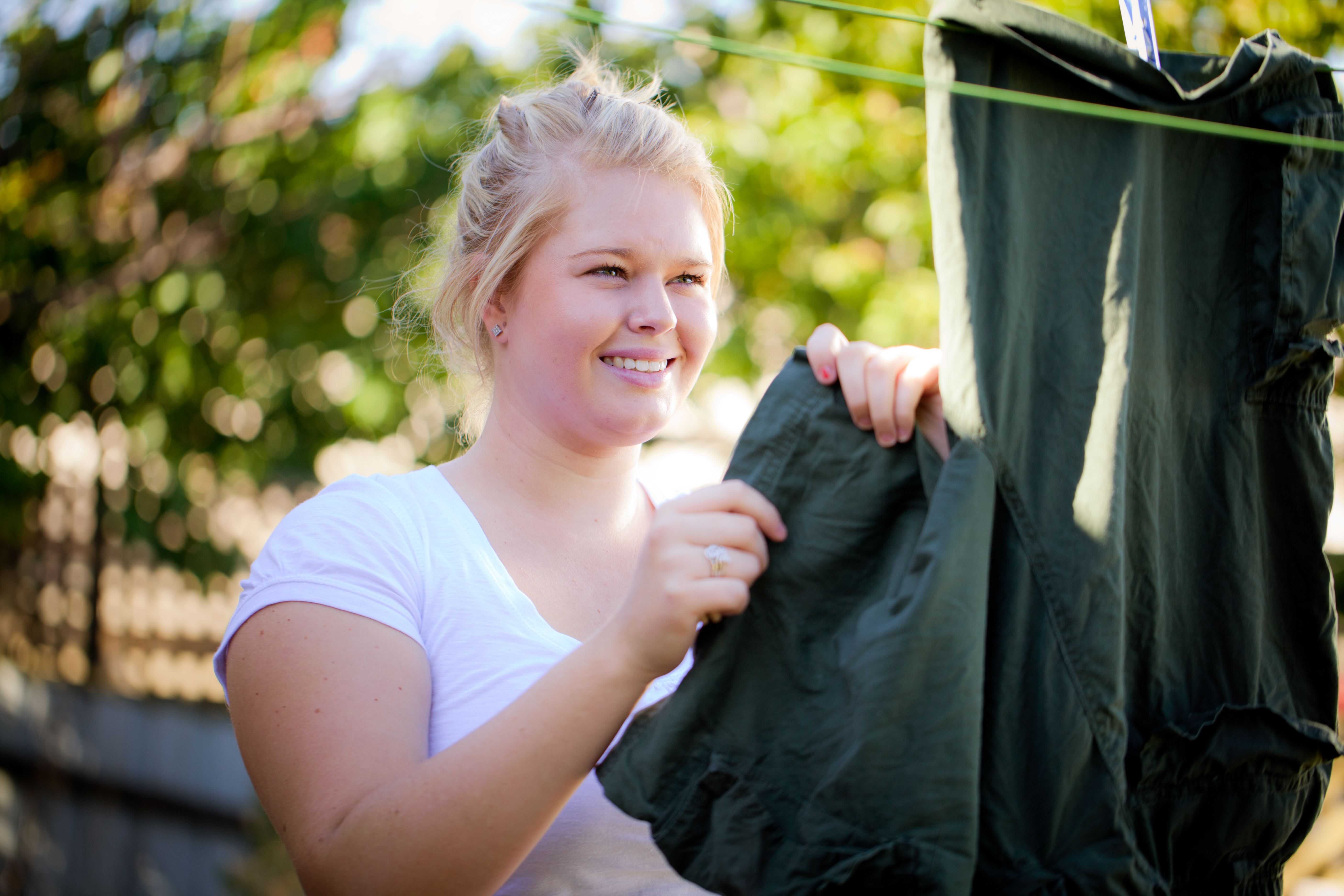 Carer hanging washing on clothes line