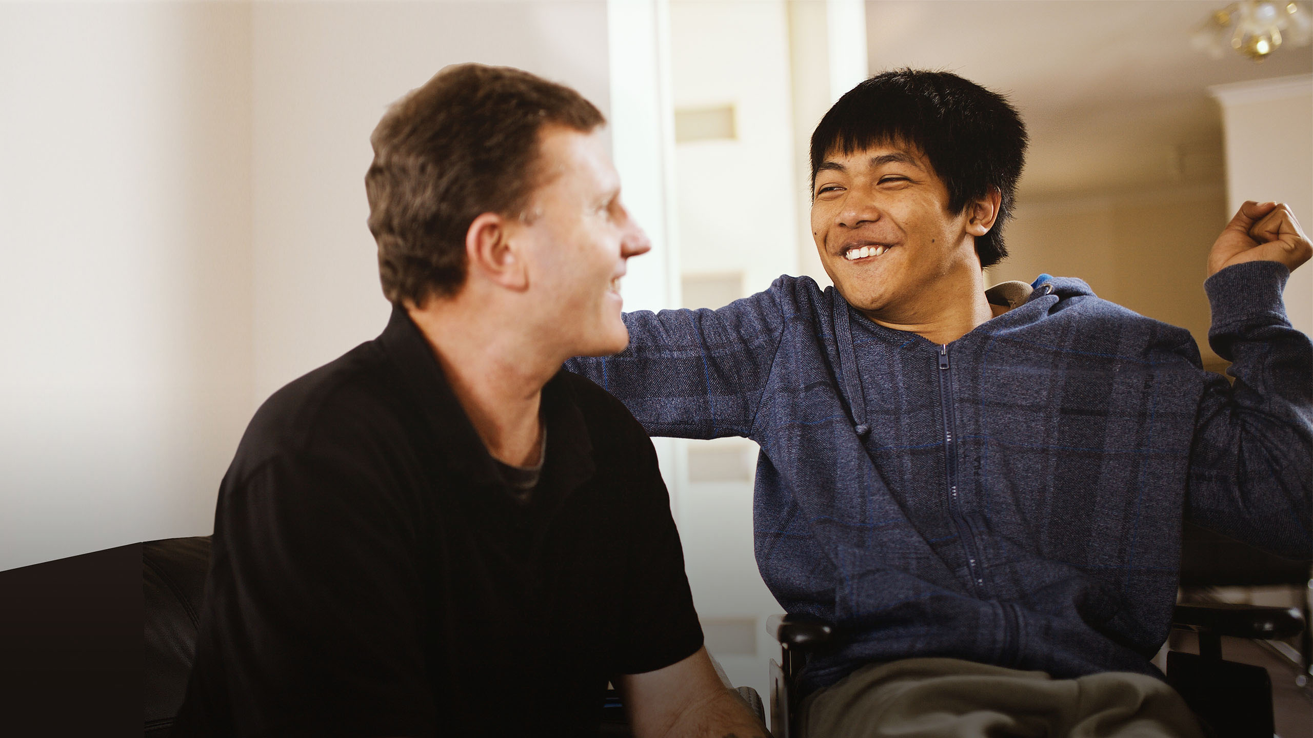 Client and carer smiling